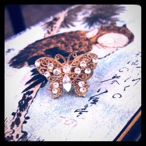 Gold tone rhinestone butterfly ring